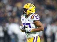 Jan 1, 2019; Glendale, AZ, USA; LSU Tigers running back Clyde Edwards-Helaire (22) against the UCF Knights in the 2019 Fiesta Bowl at State Farm Stadium. Mandatory Credit: Mark J. Rebilas-USA TODAY Sports
