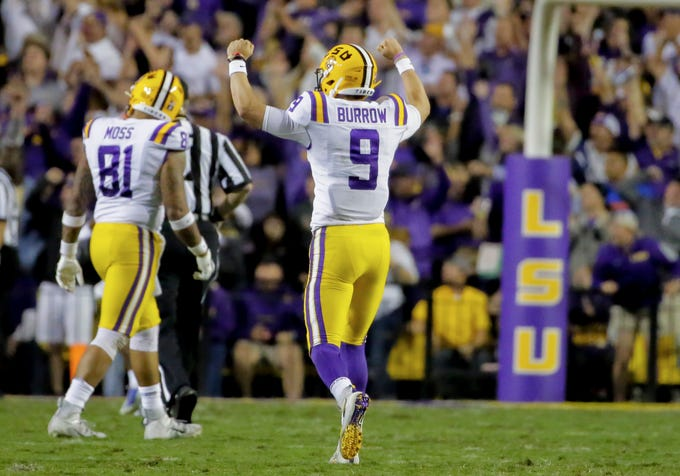 Oct 12, 2019; Baton Rouge, LA, USA; LSU Tigers quarterback Joe Burrow (9) celebrates after a touchdown against the Florida Gators during the first half at Tiger Stadium. Mandatory Credit: Derick E. Hingle-USA TODAY Sports