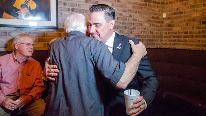 Republican Josh Guillory hugs a supporter Saturday as he earns the most votes and a spot in the Nov. 16 runoff for Lafayette mayor-president against no-party candidate Carlee Alm-LaBar.