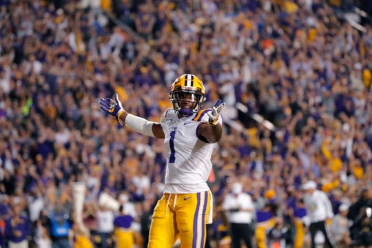 LSU wide receiver Ja'Marr Chase (1) celebrates his touchdown reception in the first half of an NCAA college football game against Florida in Baton Rouge, La., Saturday, Oct. 12, 2019. (AP Photo/Gerald Herbert)