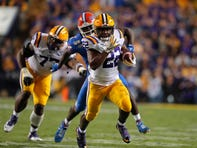 LSU running back Clyde Edwards-Helaire (22) carries on a 57-yard touchdown run in the first half of an NCAA college football game against Florida in Baton Rouge, La., Saturday, Oct. 12, 2019. (AP Photo/Gerald Herbert)
