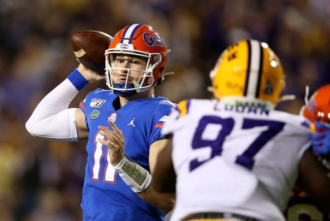 Oct 12, 2019; Baton Rouge, LA, USA; Florida Gators quarterback Kyle Trask (11) looks to throw against the LSU Tigers in the second quarter at Tiger Stadium. Mandatory Credit: Chuck Cook-USA TODAY Sports