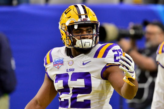 Jan 1, 2019; Glendale, AZ, USA; LSU Tigers running back Clyde Edwards-Helaire (22) looks on prior to the game against the UCF Knights in the 2019 Fiesta Bowl at State Farm Stadium. Mandatory Credit: Matt Kartozian-USA TODAY Sports