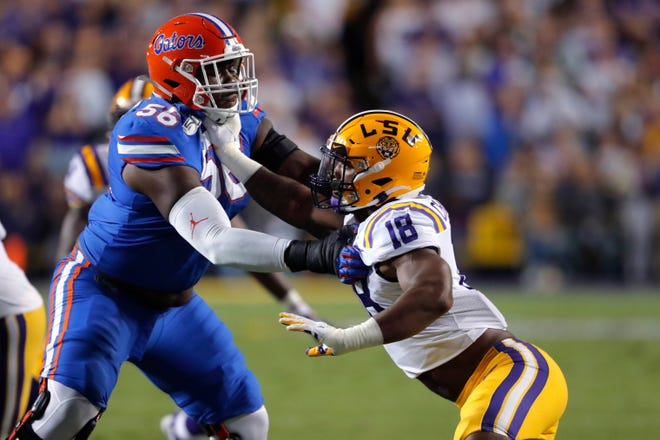 LSU linebacker K'Lavon Chaisson (18) rushes against Florida offensive lineman Jean Delance (56) in the first half of an NCAA college football game in Baton Rouge, La., Saturday, Oct. 12, 2019. (AP Photo/Gerald Herbert)