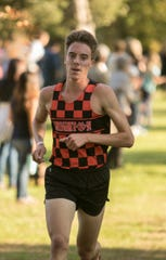 Jack Spamer of Brighton became the first Livingston County runner to break 15 minutes for 5K cross country with a 14:48.1 performance at Hudson Mills Metropark.