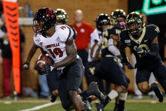 Louisville running back Hassan Hall (19) returns a kickoff for a touchdown during the first half against Wake Forest in an NCAA college football game in Winston-Salem, N.C., Saturday, Oct. 12, 2019. (AP Photo/Nell Redmond)