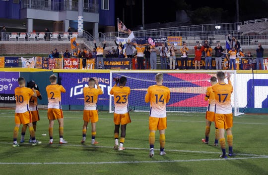 Lansing Ignite players salute fans following their 1-0 loss to Greenville Triumph, Saturday, Oct. 12, 2019, in Lansing, Mich.