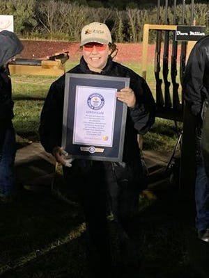 Jessie Strasser, 17, of Waterford, Wis. holds a plaque after she and four others set the Guinness World Record by breaking 14,167 clay targets in a 12-hour period. The record was set at at Powder Creek Shooting Park in Lenaxa, Kansas.