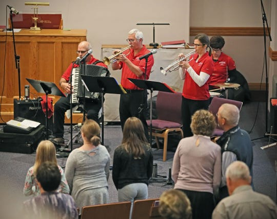The Goodtime Dutchmen play religious music with a polka beat incorporated into the service at First Lutheran Church of Beaver Dam on Sunday. The musicians are Nic Dunkel, center, on trumpet; Missy Rank, right, on trumpet and vocals; Ralph Thull, far left, on his accordion; and Lynn Thull, rear, on drums.