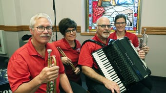 The Goodtime Dutchmen play religious music with a polka beat as their music is incorporated into the service at First Lutheran Church of Beaver Dam.