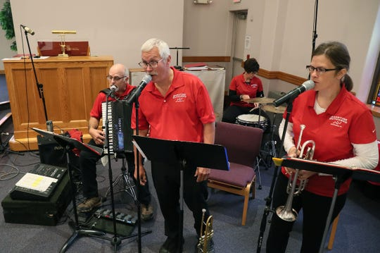 The Goodtime Dutchmen play religious music with a polka beat at First Lutheran Church of Beaver Dam on Sunday. The musicians are Nic Dunkel, center, on trumpet; Missy Rank, right, on trumpet and vocals; Ralph Thull, far left, on accordion; and Lynn Thull, rear, on drums.