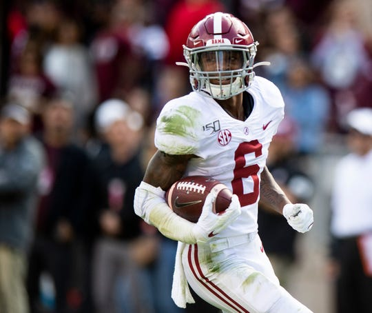 Alabama wide receiver DeVonta Smith (6) scores against Texas A&M at Kyle Field in College Station, Texas on Saturday October 12, 2019.