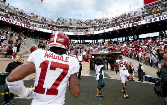 Alabama wide receiver Jaylen Waddle (17) runs off of the field after defeating Texas A&M at Kyle Field in College Station, Texas on Saturday October 12, 2019.