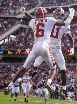 Alabama wide receivers DeVonta Smith (6) and Henry Ruggs, III, (11) celebrate Smith's touchdown against Texas A&M at Kyle Field in College Station, Texas on Saturday October 12, 2019.