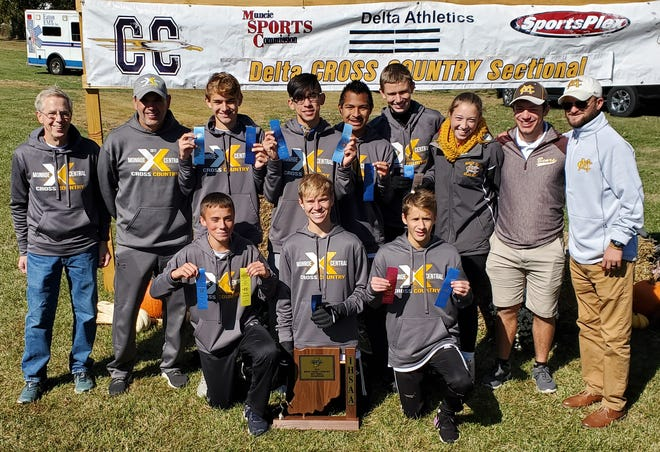 The Monroe Central boys cross country team poses for a picture following its first-ever sectional title.