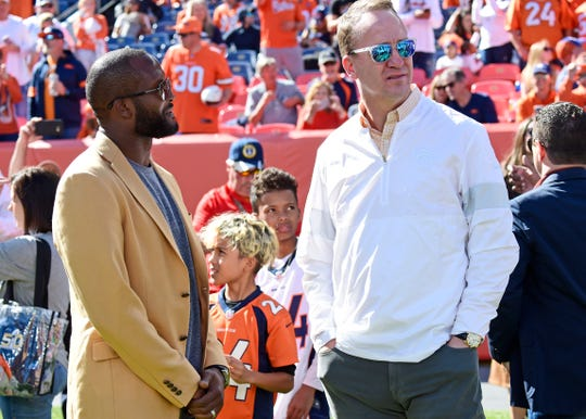 Former Denver Broncos teammates Champ Bailey and Peyton Manning chat before the game against the Tennessee Titans at Empower Field at Mile High Sunday, Oct. 13, 2019 in Denver, Colo.