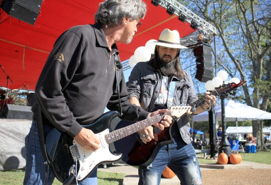 Members of the Clayton Q Band, Randy Russell and Clayton Q, come down off the stage to play at Music on Main in Ashland City, Tenn., on Saturday. Oct. 12, 2019.