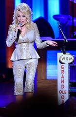 Dolly Parton performs at her 50th Opry member anniversary at the Grand Ole Opry on Oct. 12, 2019.