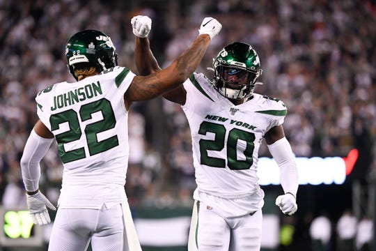 New York Jets cornerback Trumaine Johnson (22) and safety Marcus Maye (20) celebrate stopping the Cowboys short of a touchdown. The New York Jets defeat the Dallas Cowboys, 24-22, on Sunday, Oct. 13, 2019, in East Rutherford.