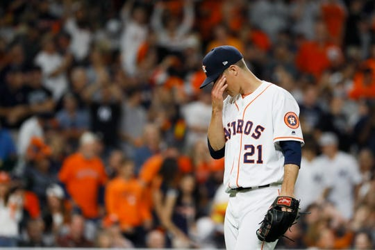 Houston Astros starting pitcher Zack Greinke reacts after giving up a home run to New York Yankees' Giancarlo Stanton during the sixth inning in Game 1 of baseball's American League Championship Series Saturday, Oct. 12, 2019, in Houston.