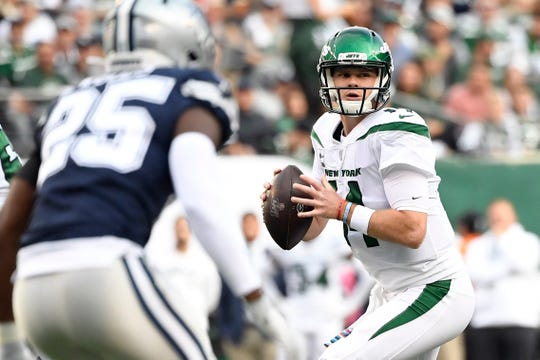 New York Jets quarterback Sam Darnold (14) looks to throw against the Dallas Cowboys in the first half. The New York Jets face the Dallas Cowboys in NFL Week 6 on Sunday, Oct. 13, 2019, in East Rutherford.