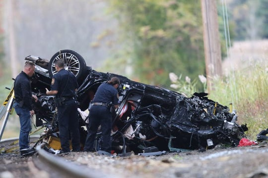 Emergency personnel are shown near a vehicle believed to be traveling on Rt. 304, and ended up on the train tracks below, near West Crooked Hill Rd.  in Pearl River, NY, Sunday, October 13, 2019.