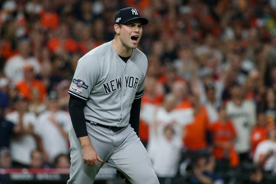 Oct 12, 2019; Houston, TX, USA; New York Yankees relief pitcher Adam Ottavino (0) reacts to a play by teammates against the Houston Astros in the seventh inning in game one of the 2019 ALCS playoff baseball series at Minute Maid Park.