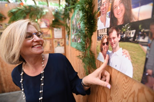Nina Kampler points to a photo of her deceased son Judah that was taken December 2012, which is displayed inside the Sukkah at their home in Teaneck, photographed on 10/13/19.