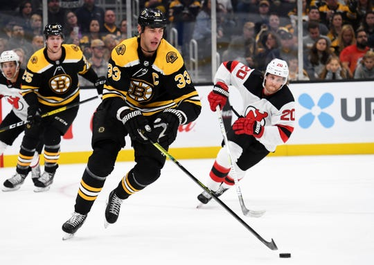 Oct 12, 2019; Boston, MA, USA; Boston Bruins defenseman Zdeno Chara (33) controls the puck away from New Jersey Devils center Blake Coleman (20) during the first period at TD Garden.