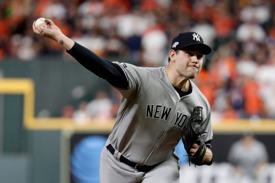 New York Yankees relief pitcher Adam Ottavino throws against the Houston Astros during the seventh inning in Game 1 of baseball's American League Championship Series Saturday, Oct. 12, 2019, in Houston.