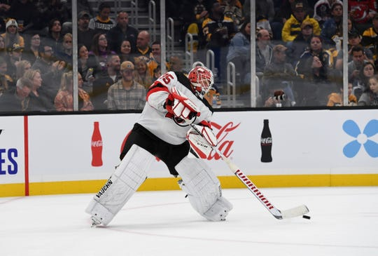Oct 12, 2019; Boston, MA, USA; New Jersey Devils goaltender Cory Schneider (35) passes the puck during the second period against the Boston Bruins at TD Garden.
