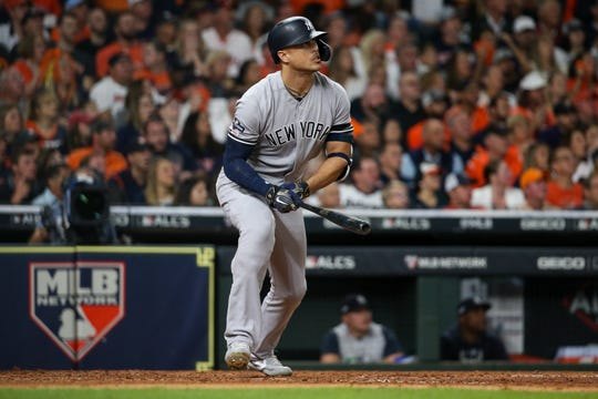 Oct 12, 2019; Houston, TX, USA; New York Yankees left fielder Giancarlo Stanton (27) hits a solo home run against the Houston Astros in the sixth inning in game one of the 2019 ALCS playoff baseball series at Minute Maid Park.