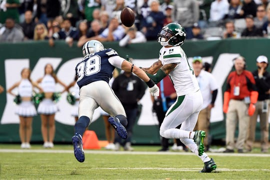 New York Jets wide receiver Robby Anderson (11) makes a 92-yard touchdown catch over Dallas Cowboys safety Jeff Heath (38) in the first half. The New York Jets face the Dallas Cowboys in NFL Week 6 on Sunday, Oct. 13, 2019, in East Rutherford.