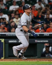 Oct 12, 2019; Houston, TX, USA; New York Yankees third baseman Gio Urshela (29) hits a solo home run against the Houston Astros in the ninth inning in game one of the 2019 ALCS playoff baseball series at Minute Maid Park.