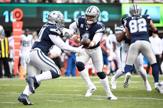 Dallas Cowboys quarterback Dak Prescott (4) hands the ball off to running back Ezekiel Elliott (21) in the first half. The New York Jets face the Dallas Cowboys in NFL Week 6 on Sunday, Oct. 13, 2019, in East Rutherford.