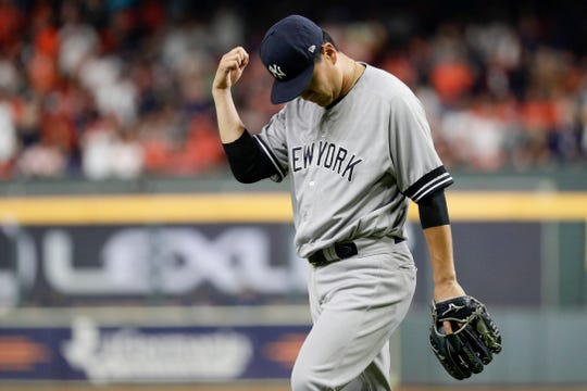 New York Yankees starting pitcher Masahiro Tanaka celebrates the end of the top of the fifth inning in Game 1 of baseball's American League Championship Series against the Houston Astros Saturday, Oct. 12, 2019, in Houston.