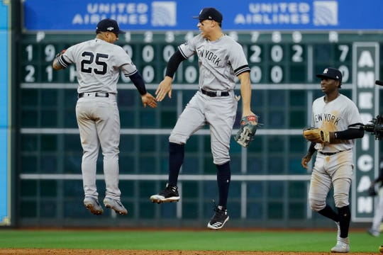 New York Yankees second baseman Gleyber Torres, left, and right fielder Aaron Judge celebrate after their win against the Houston Astros in Game 1 of baseball's American League Championship Series Saturday, Oct. 12, 2019, in Houston.