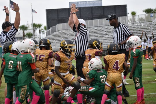 The East Pensacola Rattlers produce a game-winning safety in the final 90 seconds of their 8-6 win against the SYSA Tigers in Saturday's 28th annual Soul Bowl.