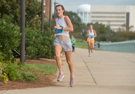 Runners make their way to the finish line during the Pensacola Half Marathon and 5k Sunday, October 13, 2019.  One of Pensacola's favorite races featuring a unique course that starts and finishes at Maritime Park.