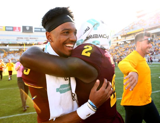 Arizona State Sun Devils quarterback Jayden Daniels (5) and  wide receiver Brandon Aiyuk (2) celebrate their 38-34 win over Washington State on Oct. 12, 2019 in Tempe, Ariz.