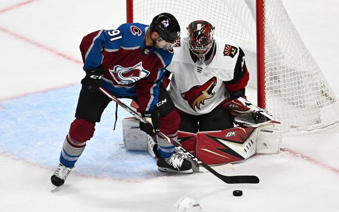 Oct 12, 2019; Denver, CO, USA; Colorado Avalanche center Nazem Kadri (91) attempts to screen Arizona Coyotes goaltender Antti Raanta (32) in the second period at the Pepsi Center. Mandatory Credit: Ron Chenoy-USA TODAY Sports