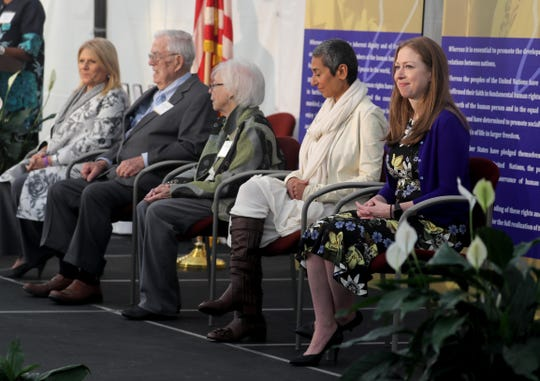 Chelsea Clinton, rights, sits with fellow honorees who received the 2019 Eleanor Roosevelt Val-Kill Medal during a ceremony at the Eleanor Roosevelt National Historic Site in Hyde Park, N.Y. Oct. 13, 2019. Clinton was one the five human rights and social justice activists to receive the medal. Hillary Clinton, a past recipient of the honor, presented her daughter with the medal. The other honorees were, Lisa Lutoff-Perio, left, President and CEO of Celebrity Cruises, John Goledn, Jr. and Gloria Kidd Golden, and Zainab Salbi.
