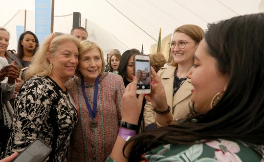 Hillary Clinton takes photos with attendees during the Eleanor Roosevelt Val-Kill Medal Ceremony at the Eleanor Roosevelt National Historic Site in Hyde Park, N.Y. Oct. 13, 2019. Clinton, a past recipient of the medal, presented her daughter Chelsea Clinton with the medal. Chelsea Clinton was among five human rights and social justice activists to receive the 2019 award.