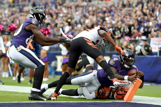 Baltimore Ravens quarterback Lamar Jackson (8) dives in for a touchdown on a run against the Cincinnati Bengals during the first half of a NFL football game Sunday, Oct. 13, 2019, in Baltimore. (AP Photo/Gail Burton)
