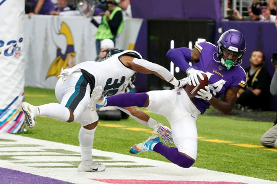 Minnesota Vikings wide receiver Stefon Diggs catches an 11-yard touchdown pass in front of Philadelphia Eagles defensive back Craig James, left, during the second half of an NFL football game, Sunday, Oct. 13, 2019, in Minneapolis. (AP Photo/Bruce Kluckhohn)