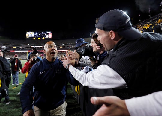 Penn State coach James Franklin celebrates Penn State's 17-12 victory over Iowa with fans following the NCAA college football game Saturday, Oct. 12, 2019, in Iowa City, Iowa. (AP Photo/Matthew Putney)