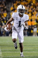 Oct 12, 2019; Iowa City, IA, USA; Penn State Nittany Lions wide receiver KJ Hamler (1) runs for a 22 yard touchdown reception from quarterback Sean Clifford (not shown) during the second quarter against the Iowa Hawkeyes at Kinnick Stadium. Mandatory Credit: Jeffrey Becker-USA TODAY Sports