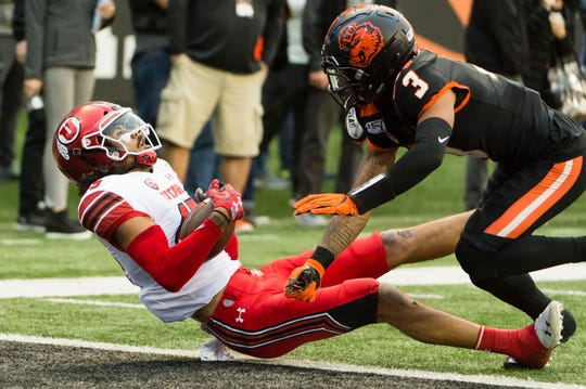 Oct 12, 2019; Corvallis, OR, USA; Utah Utes wide receiver Samson Nacua (45) catches a pass for a touchdown against Oregon State Beavers defensive back Jaydon Grant (3) during the first half at Reser Stadium. Mandatory Credit: Troy Wayrynen-USA TODAY Sports