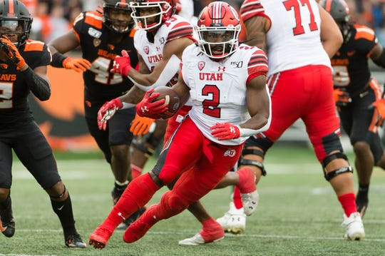 Oct 12, 2019; Corvallis, OR, USA; Utah Utes running back Zack Moss (2) picks up a first down during the first half against the Oregon State Beavers at Reser Stadium. Mandatory Credit: Troy Wayrynen-USA TODAY Sports