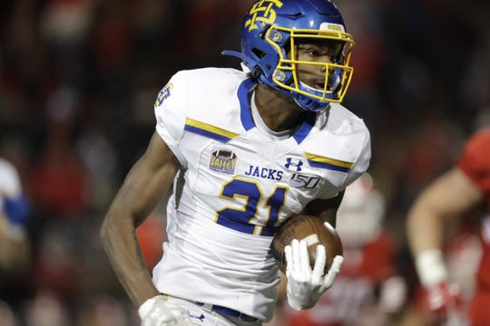 Don Gardner returns an interception for a touchdown to spark SDSU to a 38-28 win over Youngstown State Saturday night in Youngstown, Ohio.